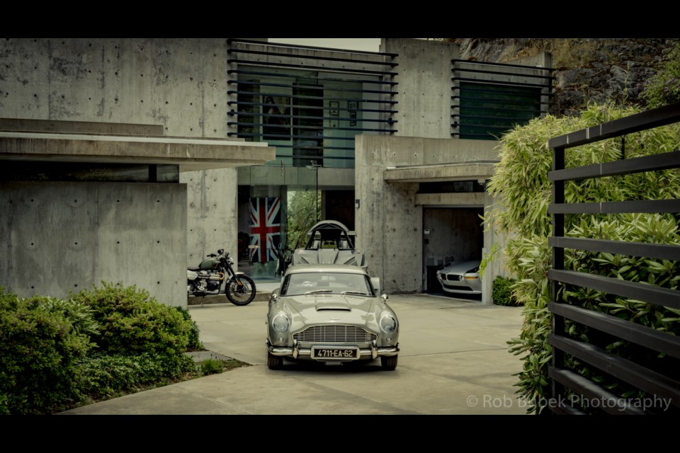The Q car hauls the Q boat with the BMW Z8 peeking out from the garage.