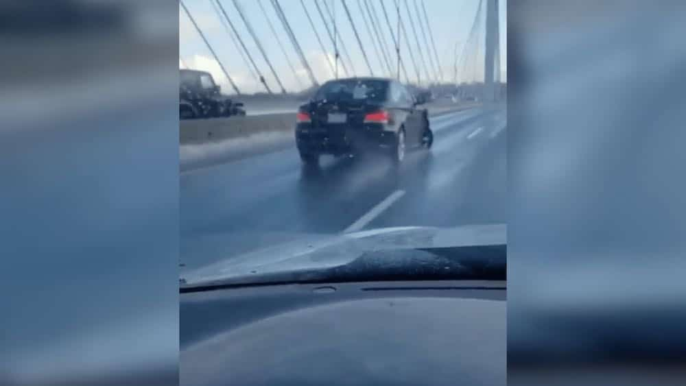Watch this BMW cross the Port Mann Bridge with a completely flat tire (VIDEO)