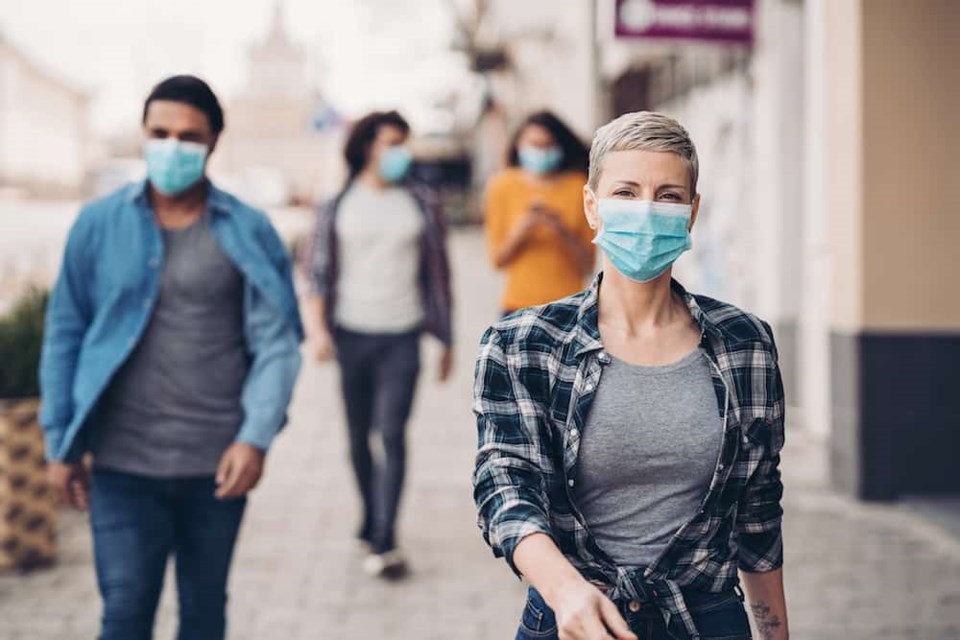 Photo: People wearing face masks / Getty Images