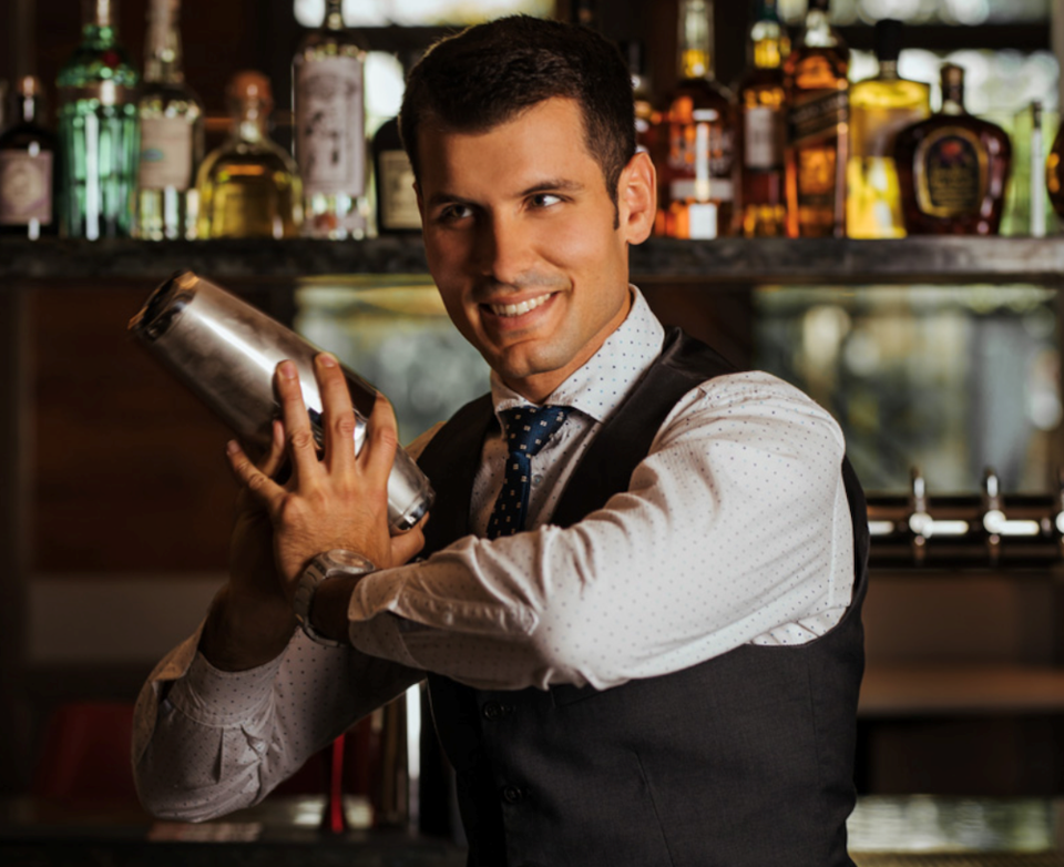 Bar manager Nico Tognon shakes up Italian-inspired cocktails at the new Tutto Restaurant and Bar in Yaletown-Vancouver
