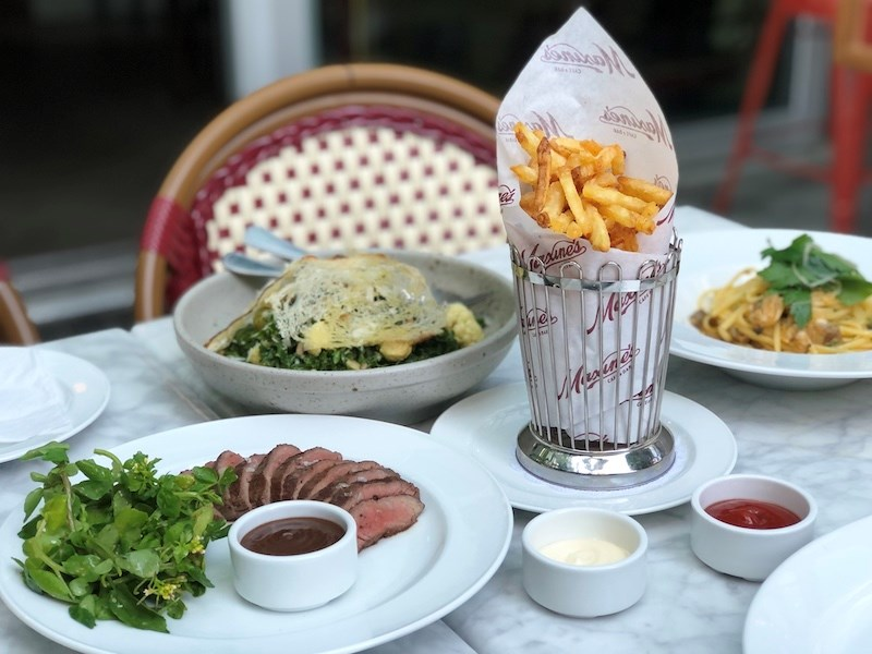 maxines-steak-frites-dishes-table