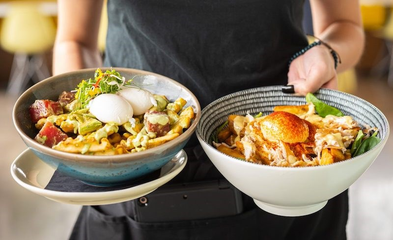 """OEB Breakfast is known for its """"soul"""" inspired all-day brunch dishes, including many that are served in generous portions in bowls."""