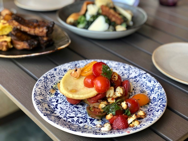 A special feature dish of grilled crumpets with goat cheese, tomatoes, strawberries, and balsamic is one of the many wildly creative - and wildly successful - dishes on the lunch menu at Roar