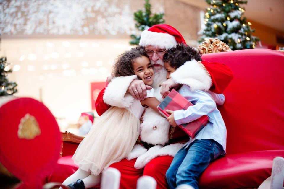 Holiday season mall santa hug