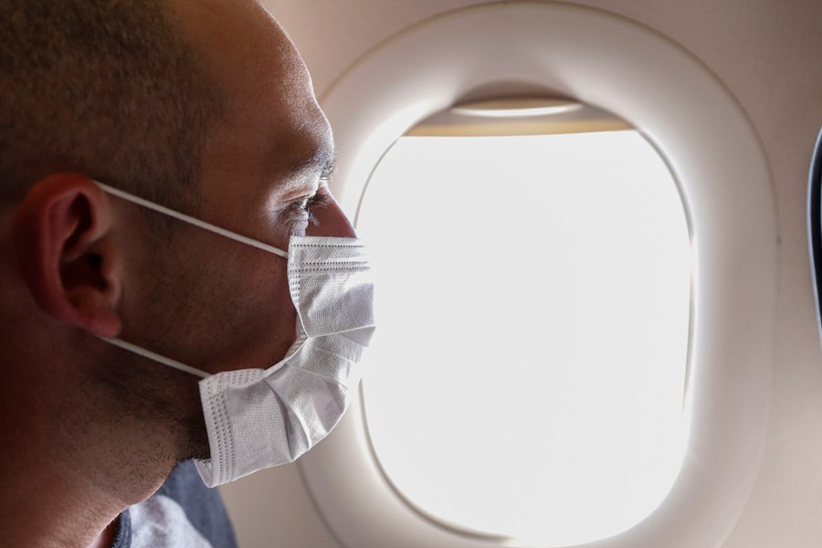 man-face-mask-airplane-flight