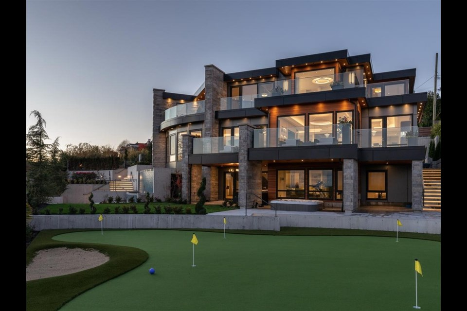 The luxury estate at 815 King Georges Way, among many features, has its very own mini-golf putting green. Photo: REW
