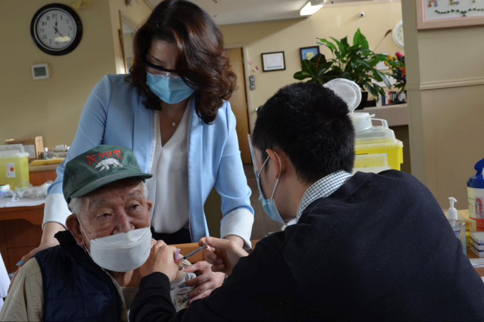 Canada's oldest man recieves COVID-19 vaccine in Metro Vancouver - Facebook photo - Amenida Seniors Community