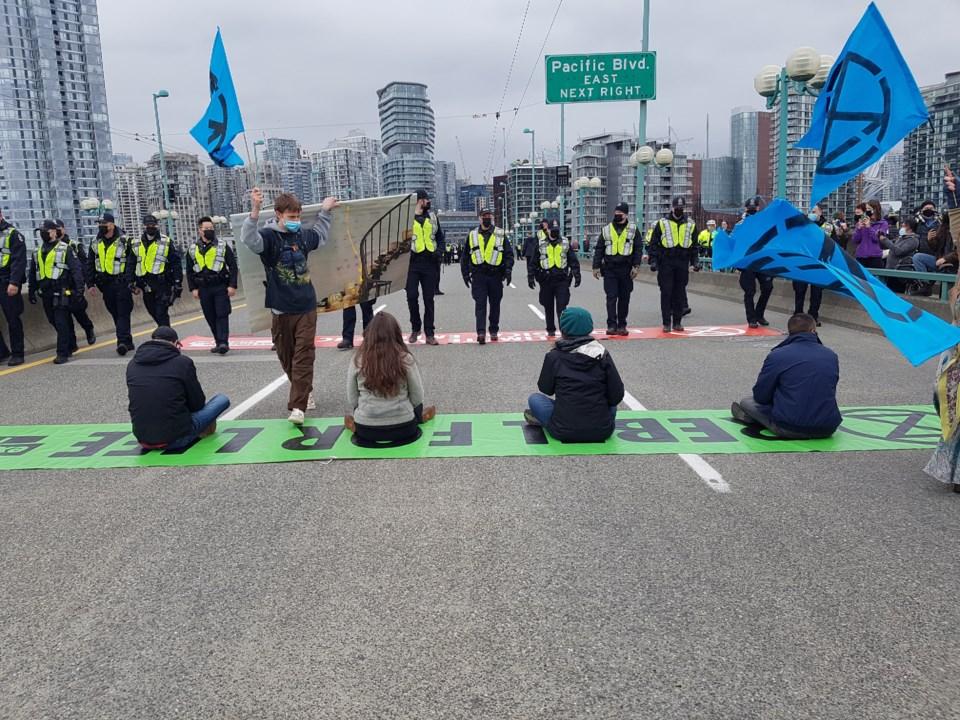 extinction rebellion cambie bridge protest arrests - Vancouver BC - Saturday, March 27