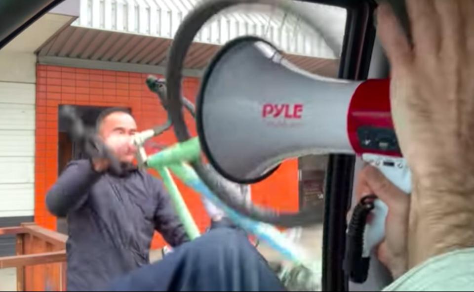 man-shoves-bike-vancouver-anti-masker.jpg