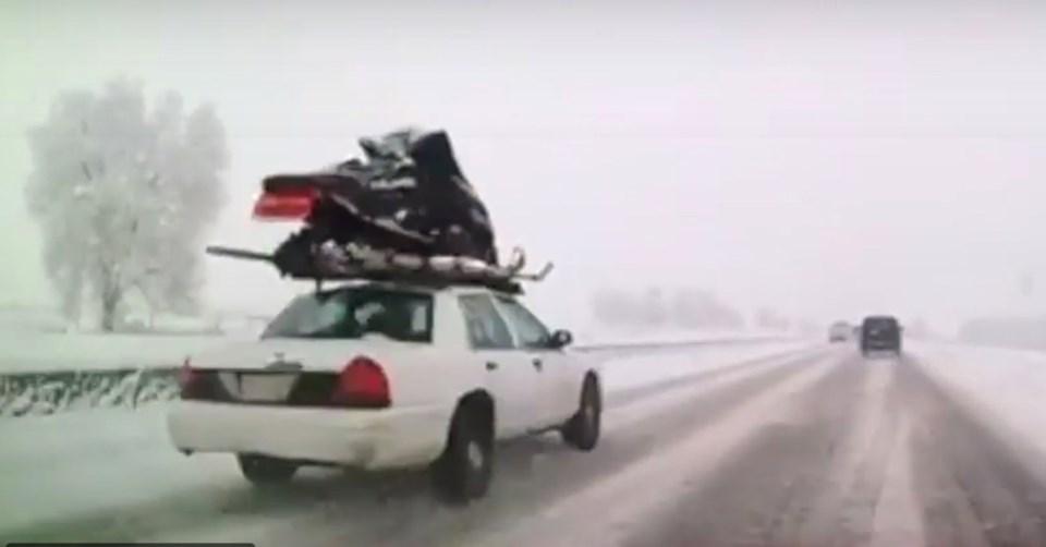 snowmobile on sedan