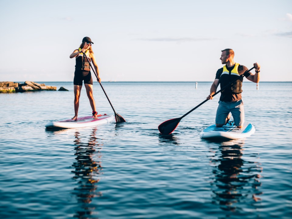 couple-paddleboarding-on-lake-gettyimages