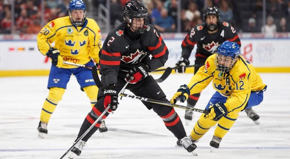 Canada.Justin.Barron.2.pursued.by.Sweden.Karl.Henriksson.20.and.Arvid.Costmar.12.Codie.McLachlan