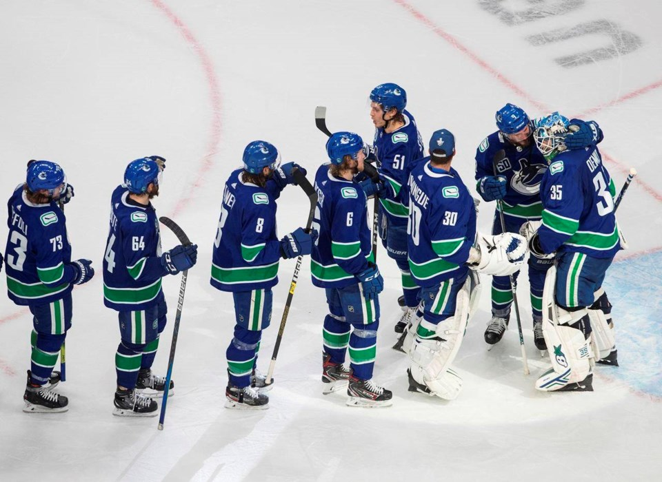 canucks celebrate 2020 playoff win jason franson cp