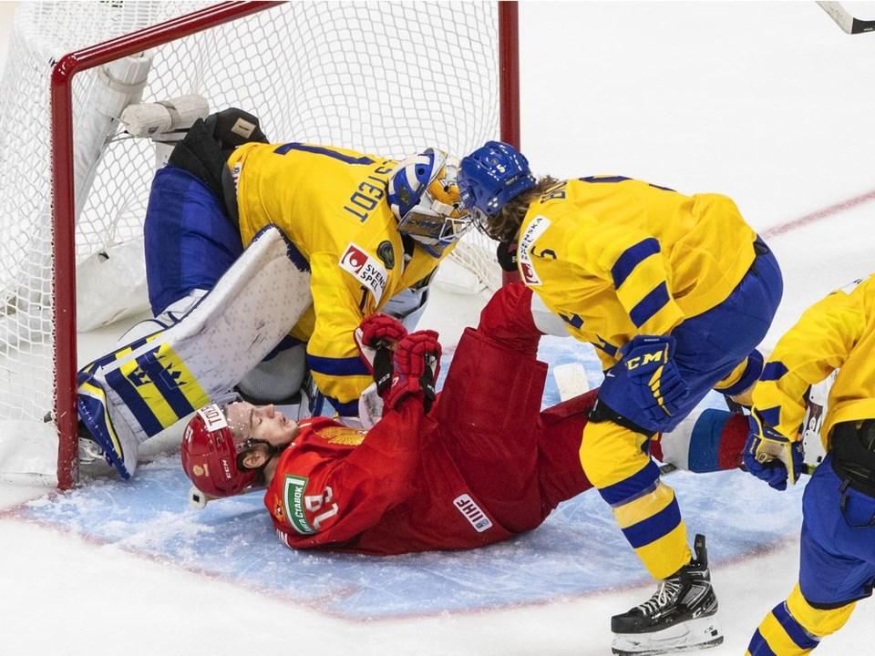 podkolzin-hko-world-junior-sweden-russia-20201230-jason-franson-cp
