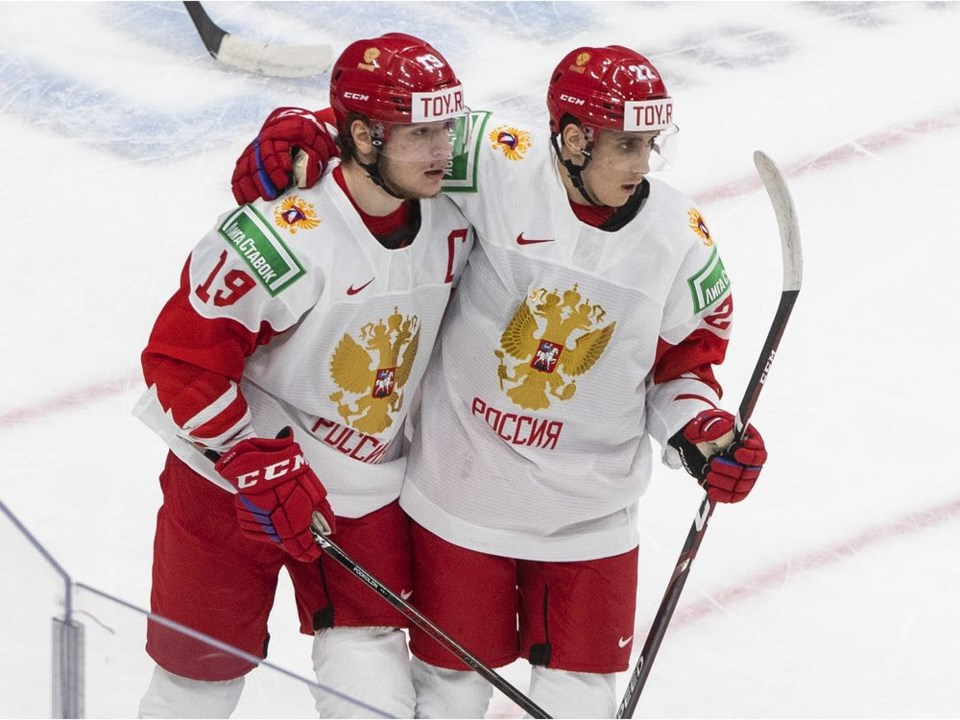 podkolzin-khusnutdinov-hko-world-junior-russia-austria-20201229-jason-franson-cp