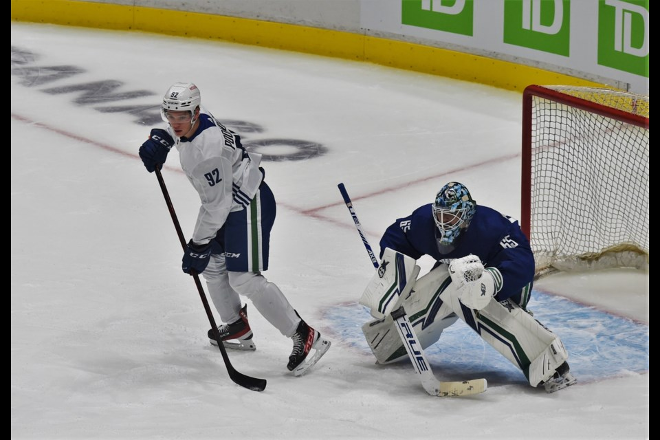 Vasily Podkolzin sets up in front of Mikey DiPietro during a drill at the first day of Canucks rookie camp on September 17, 2021.