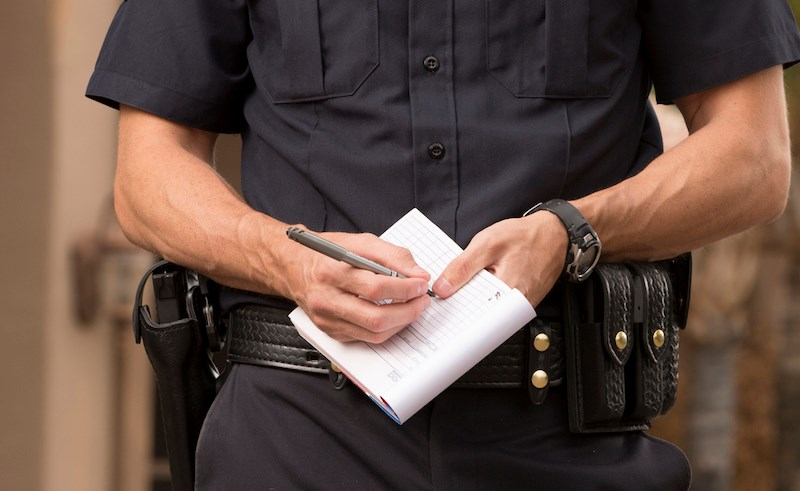 police-officer-writing-ticket-violation