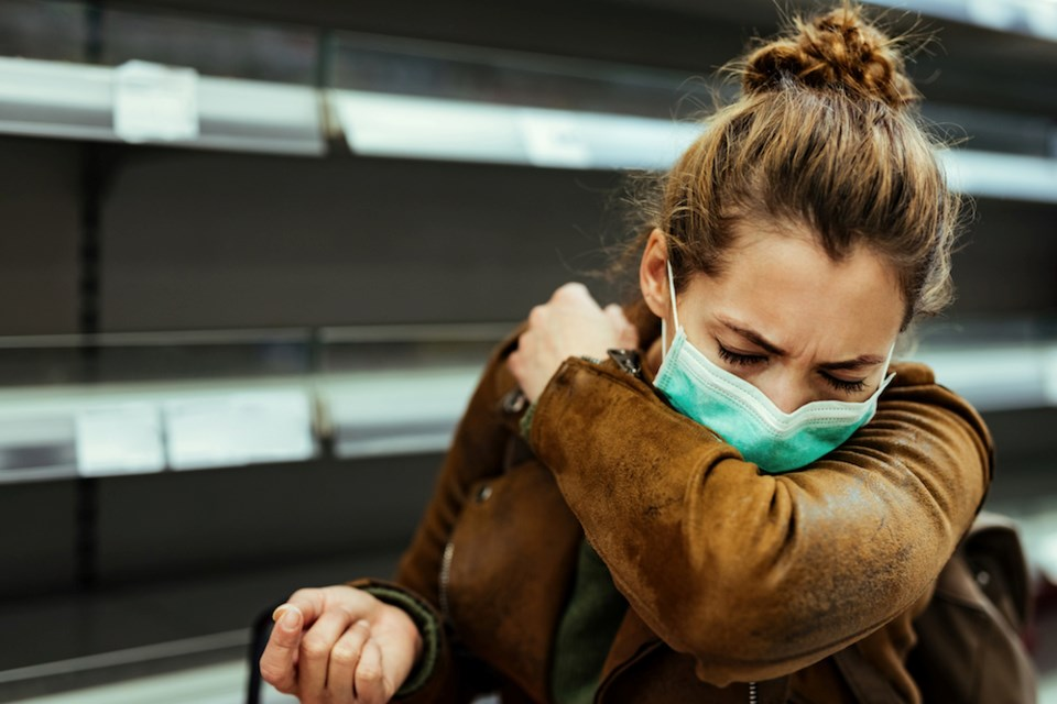 woman-coughing-mask