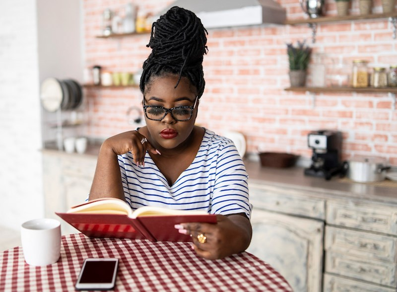 woman-reading-home-kitchen-food