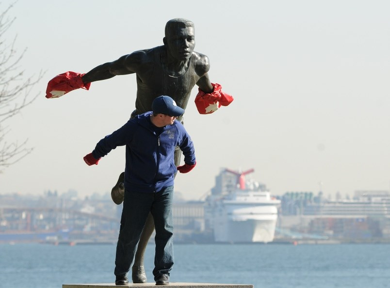 the-harry-jerome-statue-at-stanley-park-adorned-with-the-ubiquitous-red-mitts-photo-dan-toulgoet