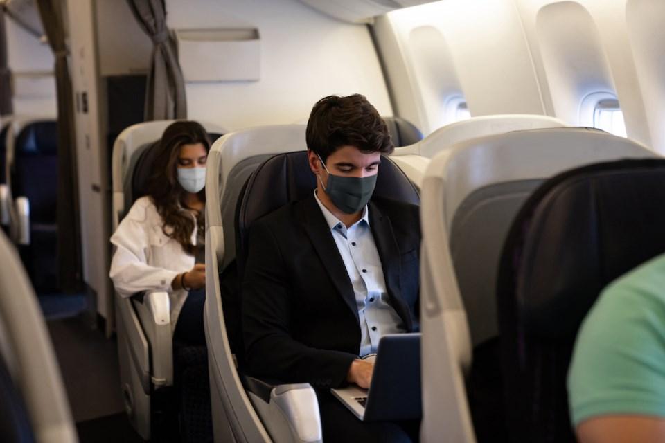 masks plane flying during coronavirus pandemic