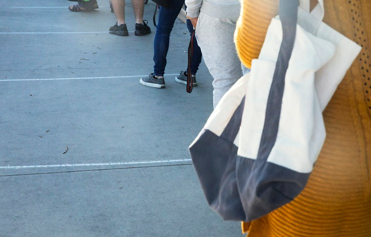 Waiting in line and practicing social distancing. Photo: stellalevi/iStock