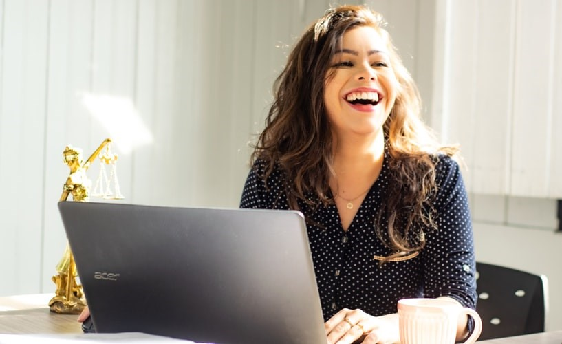 woman-smiling-laptop-unsplash