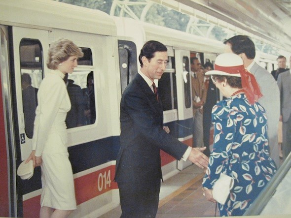 Princess Diana and Prince Charles ride the SkyTrain. Photo/The Buzzer Blog.