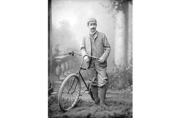 1892 - One of the first cyclists in Vancouver, Charles James Piper, poses with a safety bicycle in a studio.