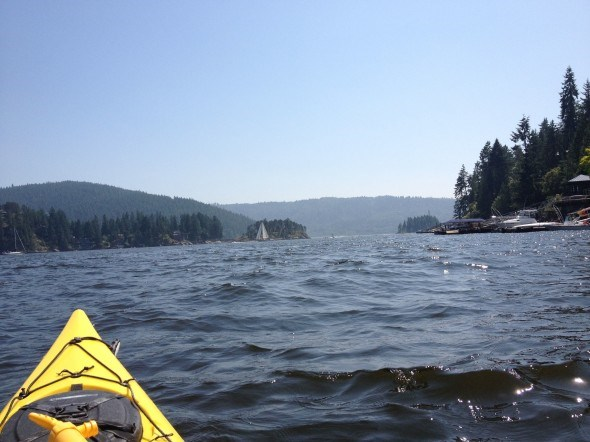 Kayaking along the shoreline of Deep Cove in Vancouver, BC
