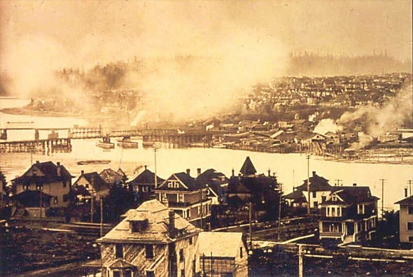 This isn't a fire, just the smoky industry-filled False Creek back in the day!