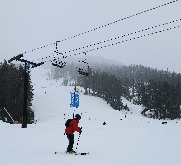 Karine skiing.