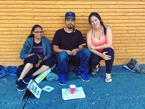 SIDEWALK supper project co-founder Andrea (right) with Acelyn (left) and Conrad (centre).