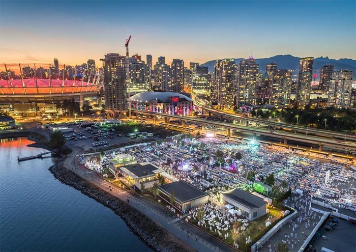 The DEBVAN 2016 event hosted more than 6,000 invited guests in an asphalt parking lot overlooking False Creek. Photo: Heliwood Media