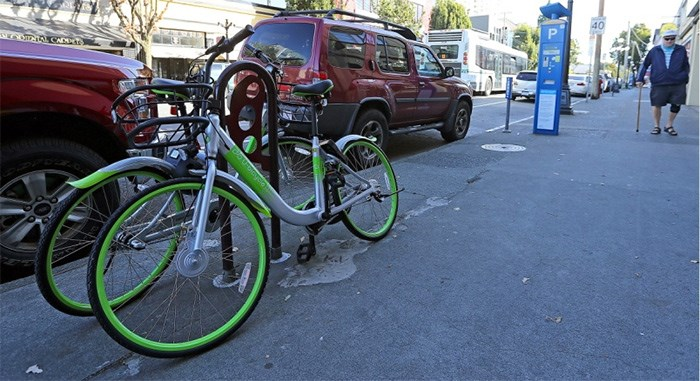 Lime-green shared bicycles from China-based U-bicycle have arrived in Victoria. Oct. 2, 2017   Photograph By ADRIAN LAM, Times Colonist