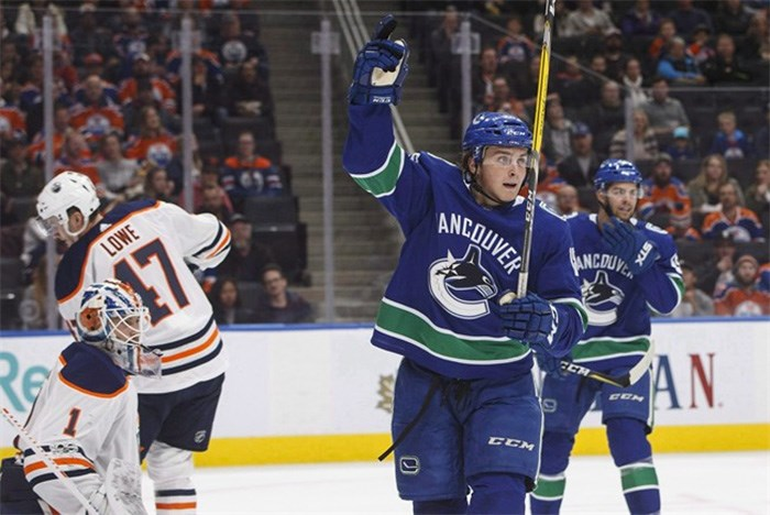 Vancouver Canucks' Jake Virtanen (18) celebrates a goal on Edmonton Oilers' goalie Laurent Brossoit (1) during first period pre-season NHL action in Edmonton, Alta., on Friday September 22, 2017. Brock Boeser spent some nervous days in his hotel room, wondering if he had done enough in training camp and pre-season to stick with the Vancouver Canucks. Virtanen only realized he made the team after seeing the hockey bag of the player he was battling for a spot packed and ready to be shipped off to the minors. THE CANADIAN PRESS/Jason Franson
