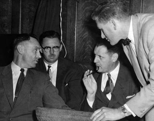 Left to right: CIB Superintendent Jack Harlon, Records Superintendent John Fisk, Chief Walter Mulligan, and Constable Stan Leacock. Photo: Vancouver Sun.