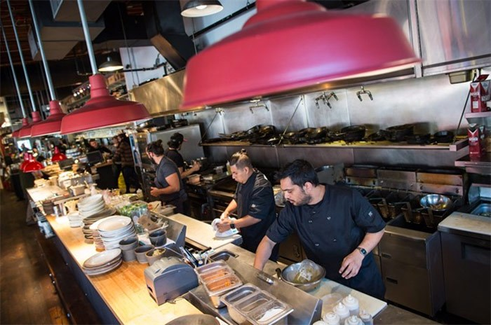Line cooks Ishaan Kohli, front right, and Abrahan Ruiz, centre, work in the kitchen at Edible Canada restaurant in Vancouver, B.C., on Wednesday October 11, 2017. The restaurant industry may be booming in British Columbia, but a combination of the high cost of living, tight profit margins and a shrinking workforce has made it difficult for kitchens to find enough staff. THE CANADIAN PRESS/Darryl Dyck