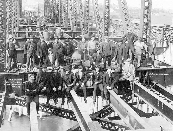 Steel workers taking a break during construction of the second bridge, 1909. Archives# CVA 1376-453.