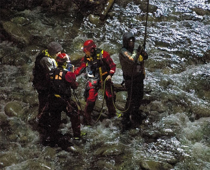 A high angle rescue is used to rescue four anglers trapped on an island in the Capilano River under the Highway 1 bridge in North Vancouver at nightfall on Wednesday. photo supplied Gerry Kahrmann/PNG