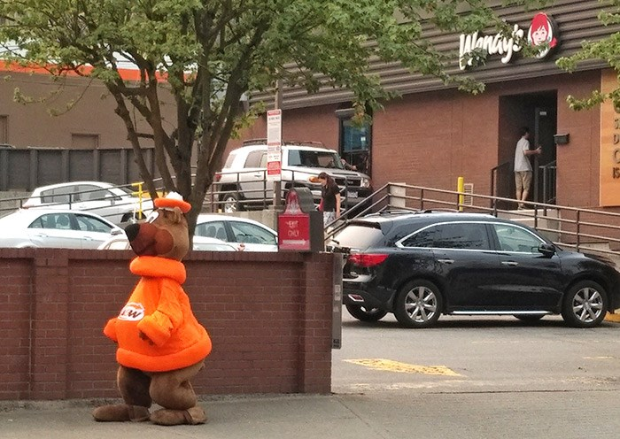 The A&W mascot seen outside Wendy's on Cambie Street in Vancouver, August 2017. Photo Bob Kronbauer