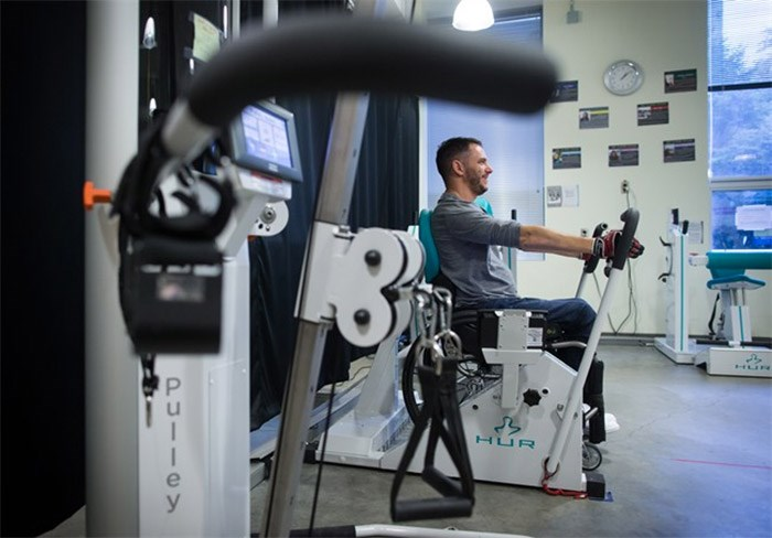 Brad Skeats, who has a spinal cord injury, works out at the Physical Activity Research Centre at the International Collaboration on Repair Discoveries, in Vancouver, B.C., on Wednesday October 25, 2017. People with spinal cord injuries now have a set of exercise guidelines for maintaining heart health to match those offered to the general population decades ago. THE CANADIAN PRESS/Darryl Dyck