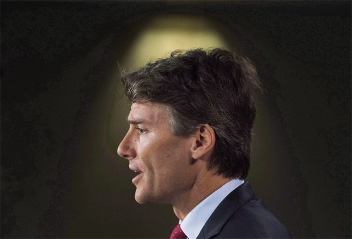 Vancouver Mayor Gregor Robertson speaks during a news conference on Parliament Hill in Ottawa on June 7, 2016. Vancouver Mayor Gregor Robertson is warning homeowners that if they fail to declare their property status by Feb. 2, they will face the city's empty homes tax plus a $250 fine. THE CANADIAN PRESS/Adrian Wyld