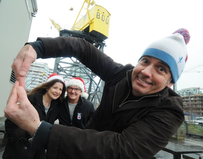 Lower Lonsdale Business Improvement Area executive director Greg Holmes spins a vision of the Sky Wheel for BIA buddies Mitra Sawyer and Andrew Klaver. The BIA is sponsoring a ferris wheel-style ride at the city's Shipbuilders Christmas Festival Dec. 2-3. photo Mike Wakefield, North Shore News
