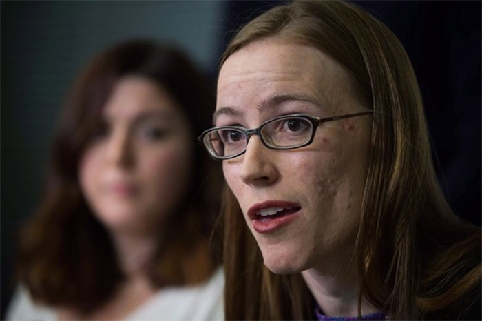 Former University of British Columbia students Glynnis Kirchmeier and Caitlin Cunningham, back, hold a news conference at the university in Vancouver, B.C., on Sunday, November 22, 2015 regarding the university's response to alleged sexual assaults by a former student who was expelled recently. The University of British Columbia has denied mishandling sexual assault reports in documents filed with the province's human rights tribunal. THE CANADIAN PRESS/Darryl Dyck