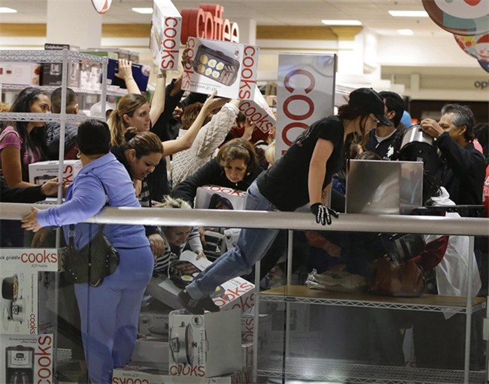 Shoppers rush to grab electric griddles and slow cookers on sale for $8 shortly after the doors opened at a J.C. Penney story in Las Vegas on November 23, 2012. THE CANADIAN PRESS/AP, Julie Jacobson.