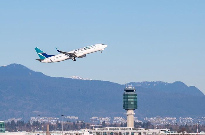 A WestJet plan takes off from YVR/Shutterstock