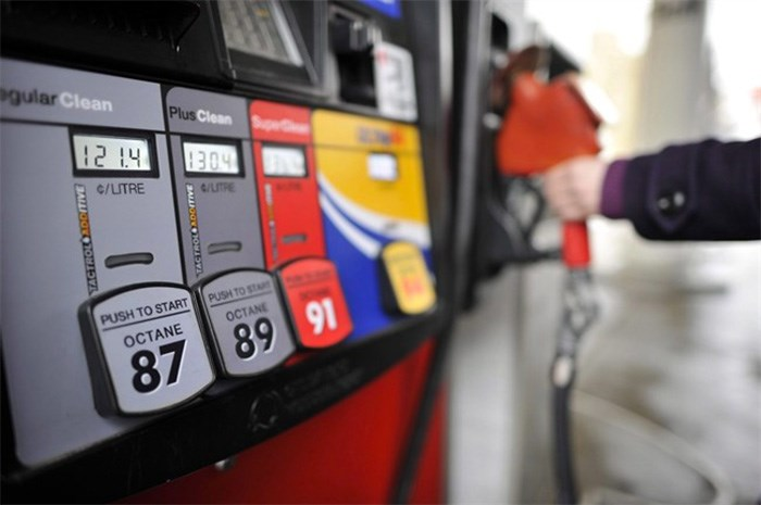 A motorist reaches for the pump at a gas station in Toronto on Thursday, February 24, 2011. THE CANADIAN PRESS/Patrick Dell