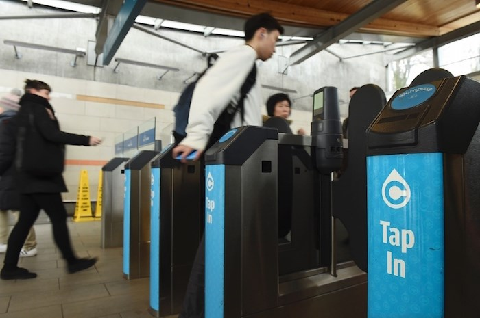 Tapping in at a TransLink Canada Line station. File photo by Dan Toulgoet
