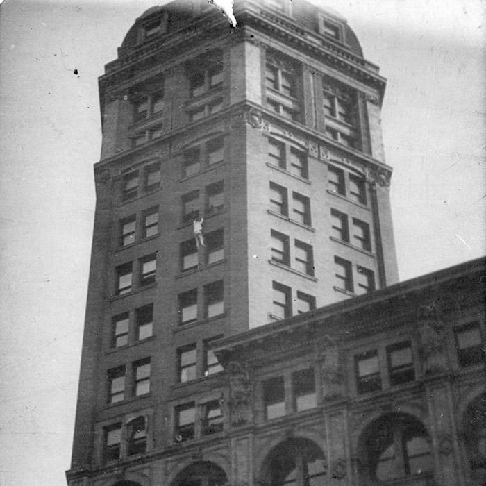 Harry Gardiner climbing the World Building. Vancouver Archives Item: Bu P734